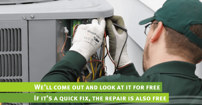 hvac tech works on home system
